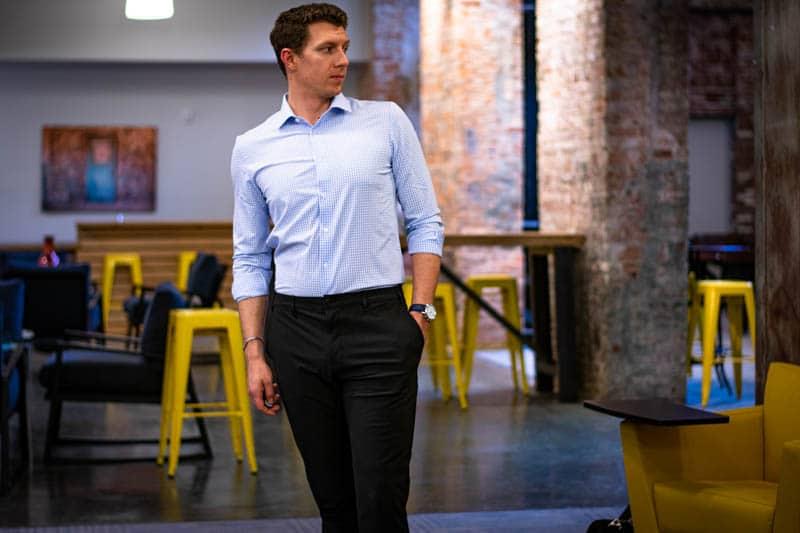 model wearing truwear performance dress shirt and prodigy pants