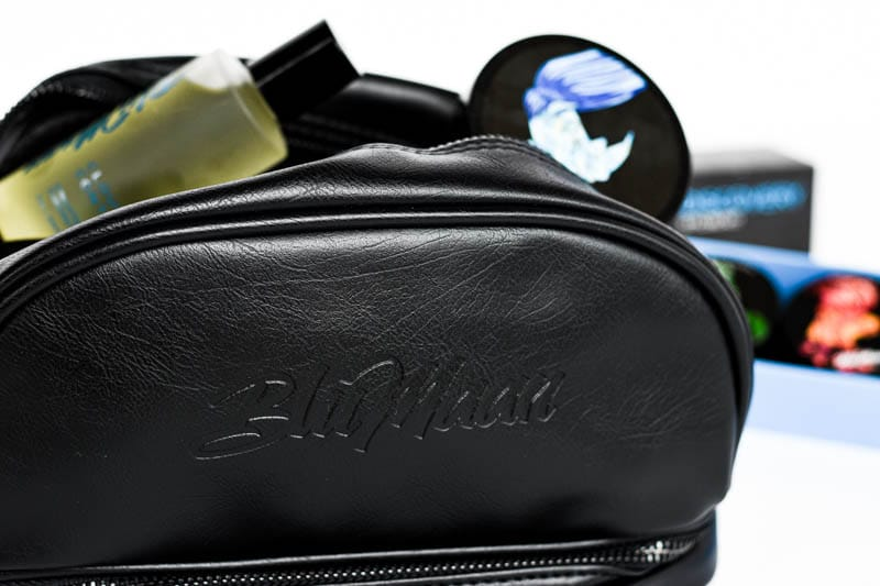 blumaan black leather dopp kit with hair styling products