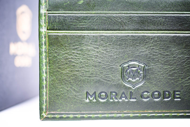 closeup green leather moral code wallet