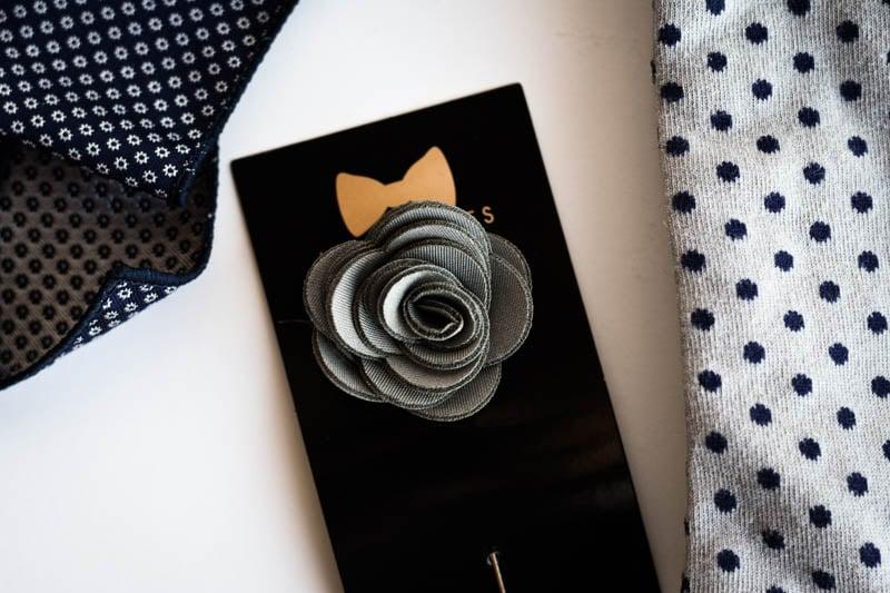 grey lapel flower