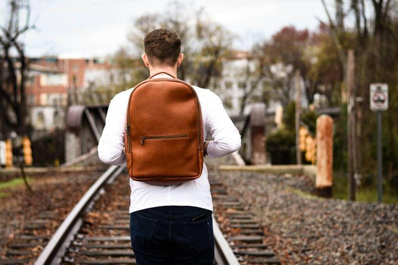 model holding straps of full grain leather backpack