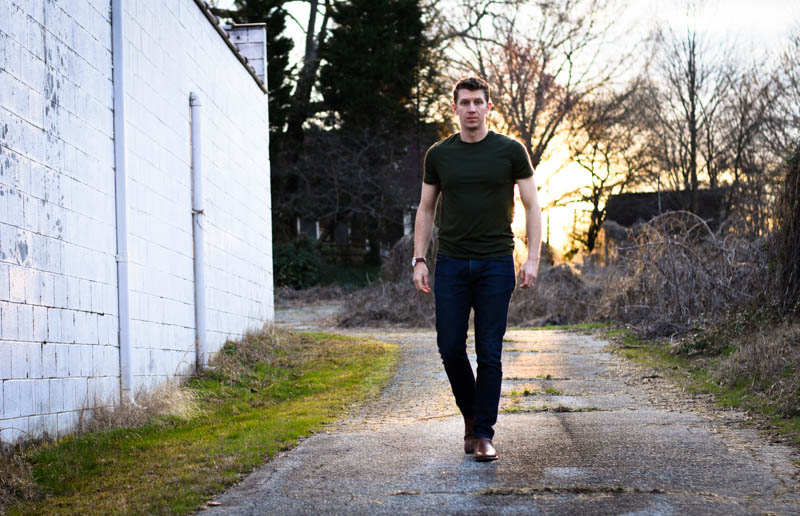 model walking with threshold tshirt jeans and chelsea boots sunset
