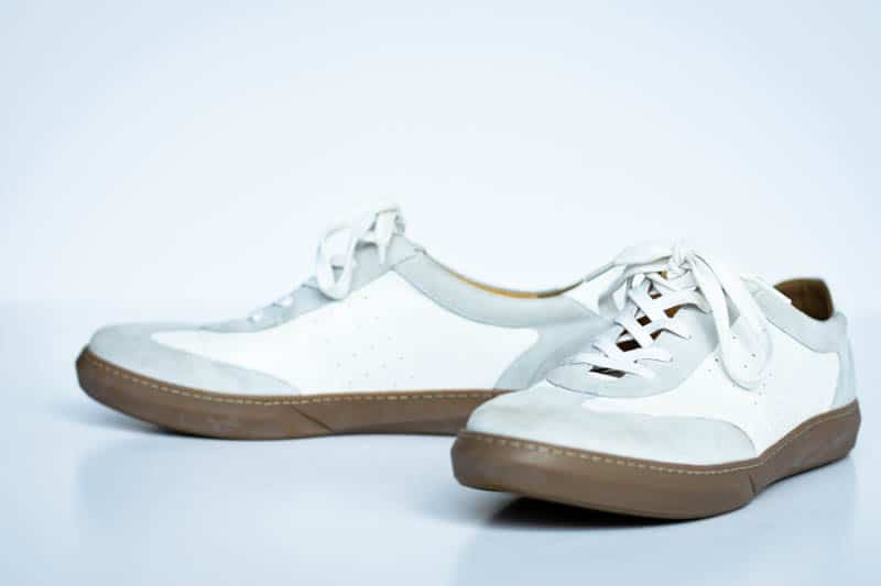 white leather brooks sneakers from moral code on white background