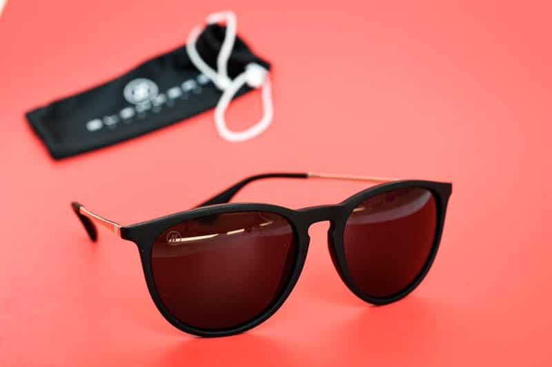 Blenders Eyewear university heights on red background sunglasses