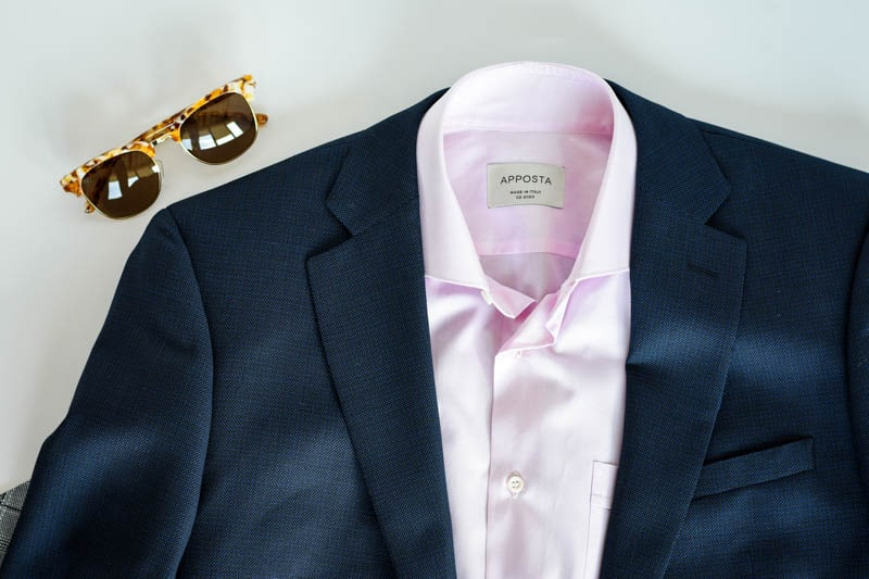 blue suit with pink shirt and sunglasses