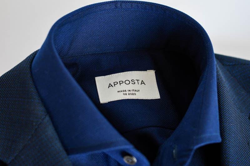 closeup of apposta dark blue shirt collar with navy suit