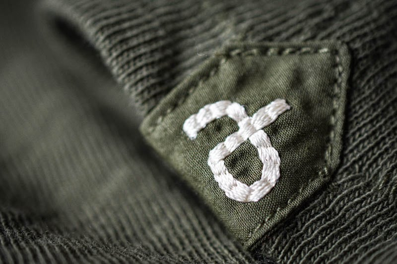 closeup of rb patch on green rag and bone tshirt