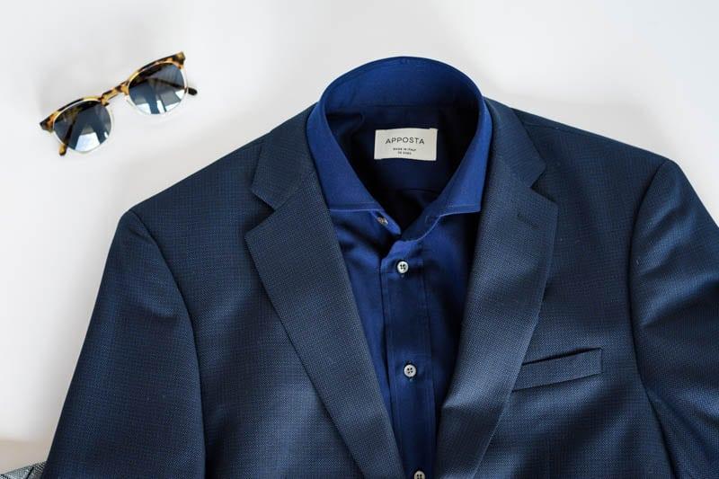 flatlat of navy suit sunglasses and dark blue shirt