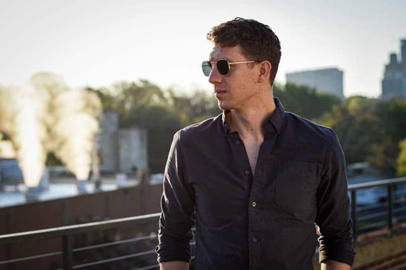 blenders eyewear review featured image model wearing whiskey shiner hexagram sunglasses against sunrise