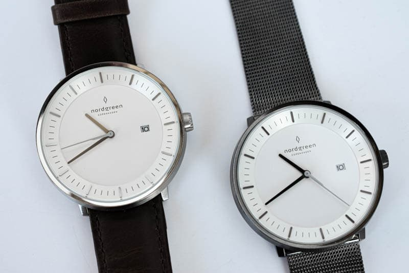 two philosopher watches side by side leather band and stainless steel band on white background