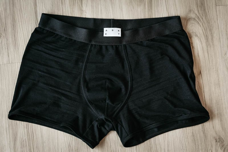 asket black boxer briefs product shot against wood background