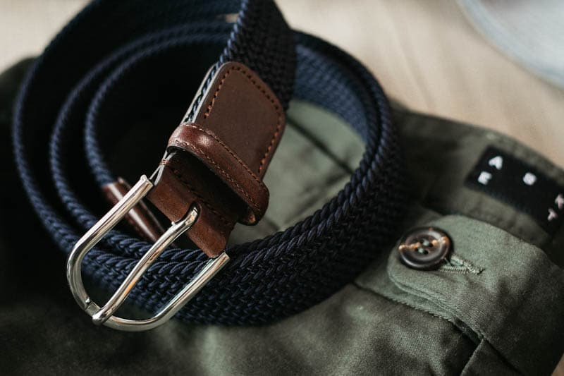 closeup navy woven belt details with horn button on asket chino