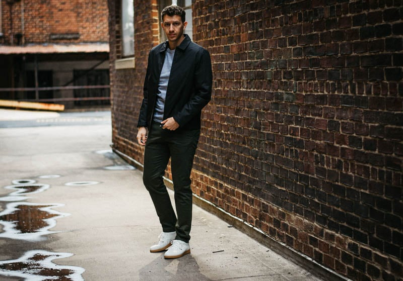 model standing in alley with asket minimalist outfit