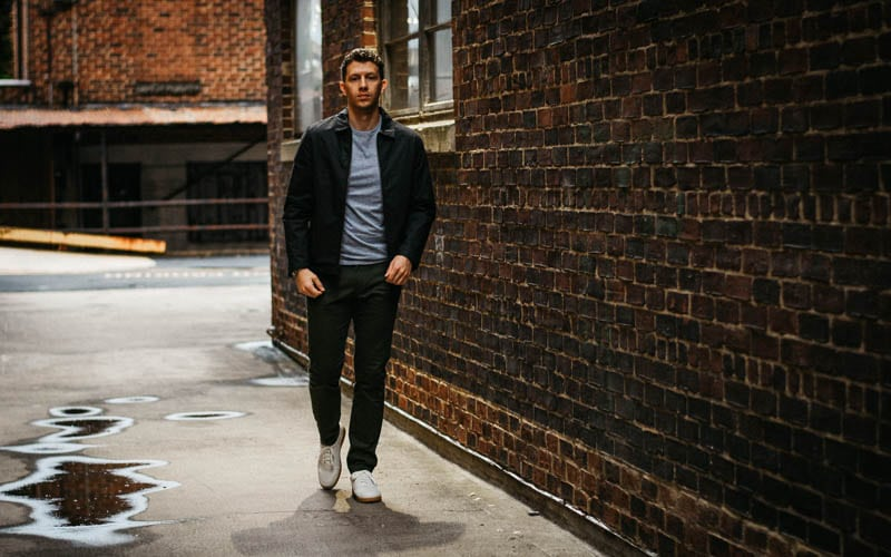 model walking in alley with asket minimalist outfit