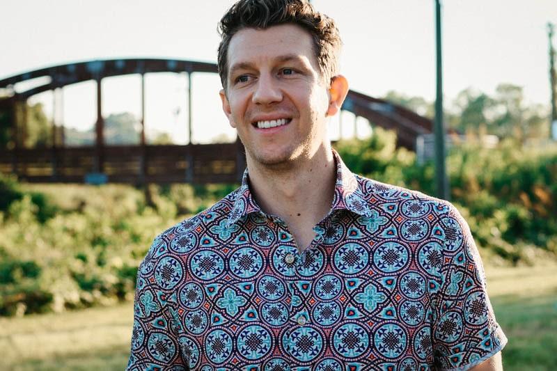 model smiling wearing robert graham short sleeve shirt