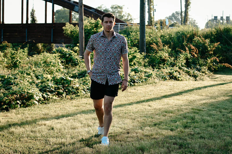 model walking toward camera wearing robert graham shirt